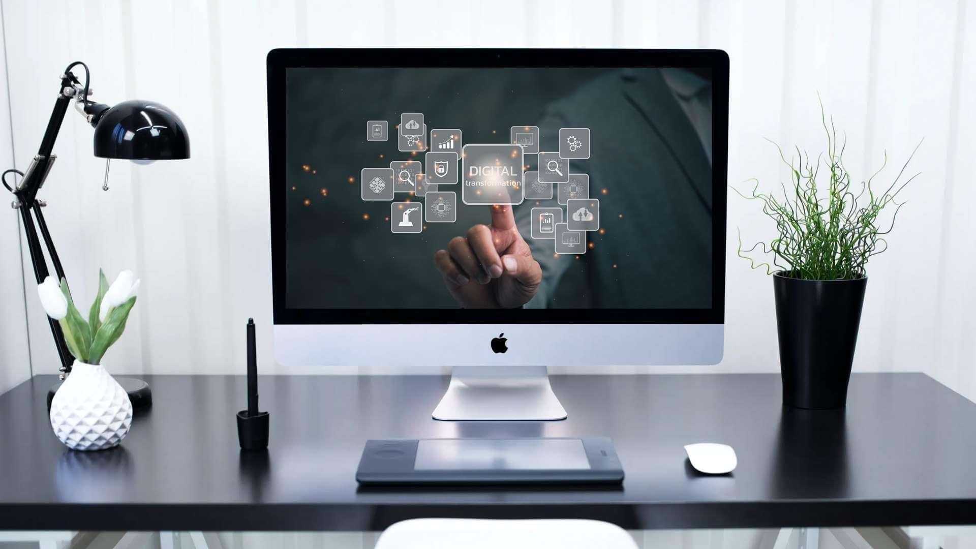 desktop computer showing digital transformation written on the screen